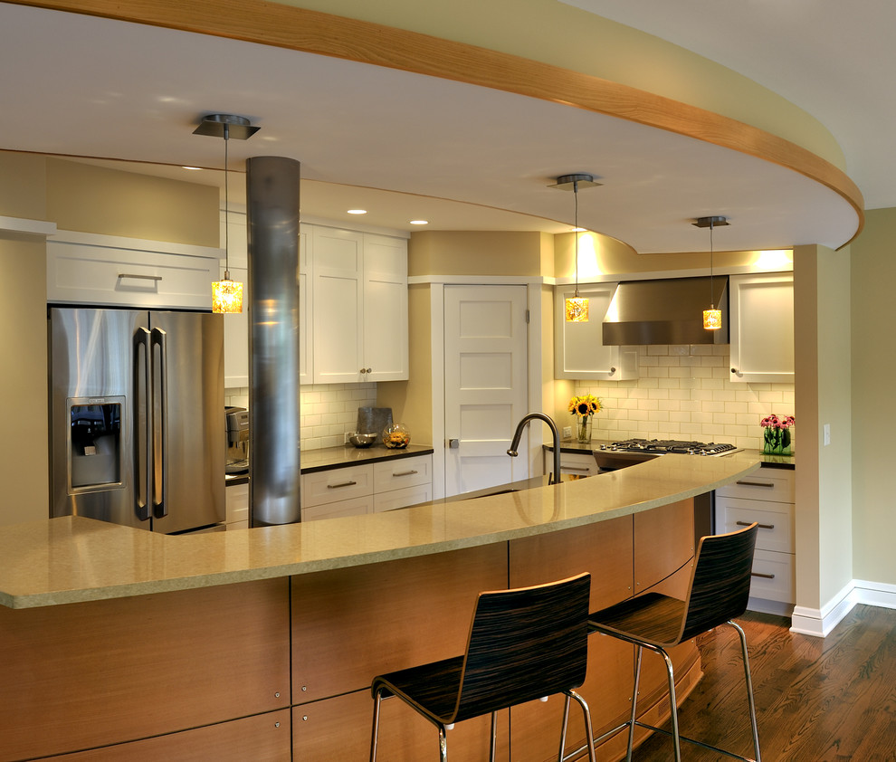 Kitchen - contemporary kitchen idea in Minneapolis with subway tile backsplash and stainless steel appliances
