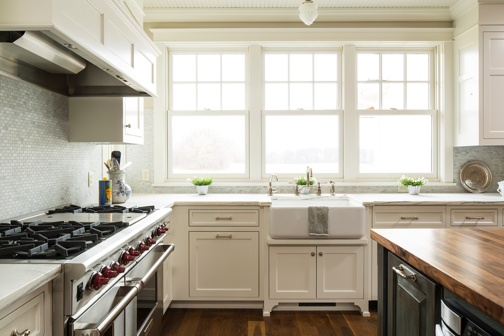 Inspiration for a cottage kitchen remodel in Minneapolis with a farmhouse sink and marble countertops