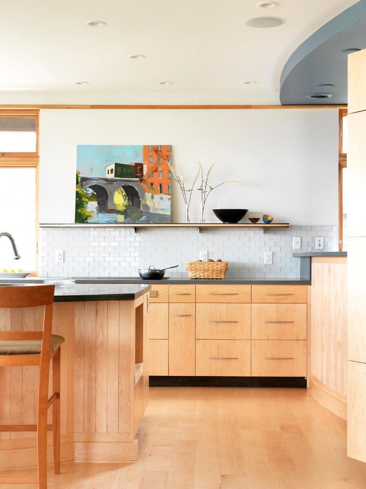 Trendy kitchen photo in Burlington with flat-panel cabinets, light wood cabinets, white backsplash and subway tile backsplash