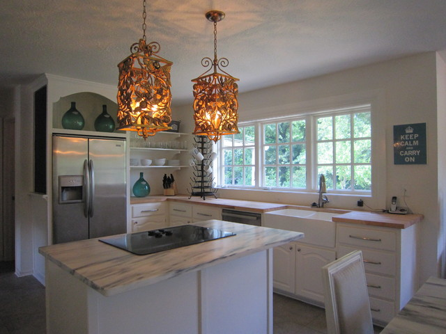 Eclectic l-shaped porcelain floor open concept kitchen photo in Dallas with a farmhouse sink, raised-panel cabinets, white cabinets, wood countertops, stainless steel appliances and an island