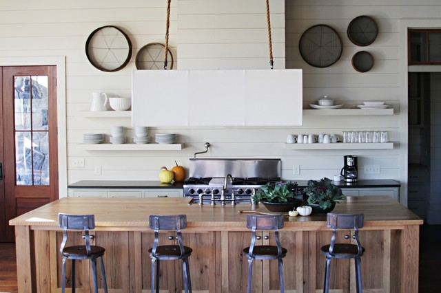 Inspiration for a beach style kitchen remodel in Atlanta with open cabinets, stainless steel appliances, wood countertops and gray cabinets