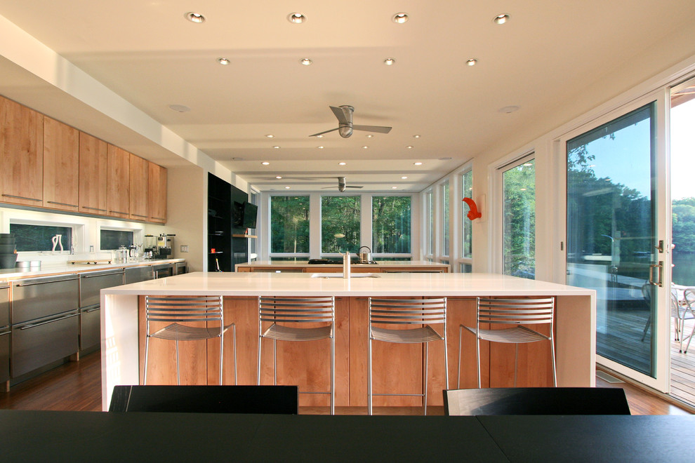 Inspiration for a modern kitchen remodel in New York with flat-panel cabinets and light wood cabinets