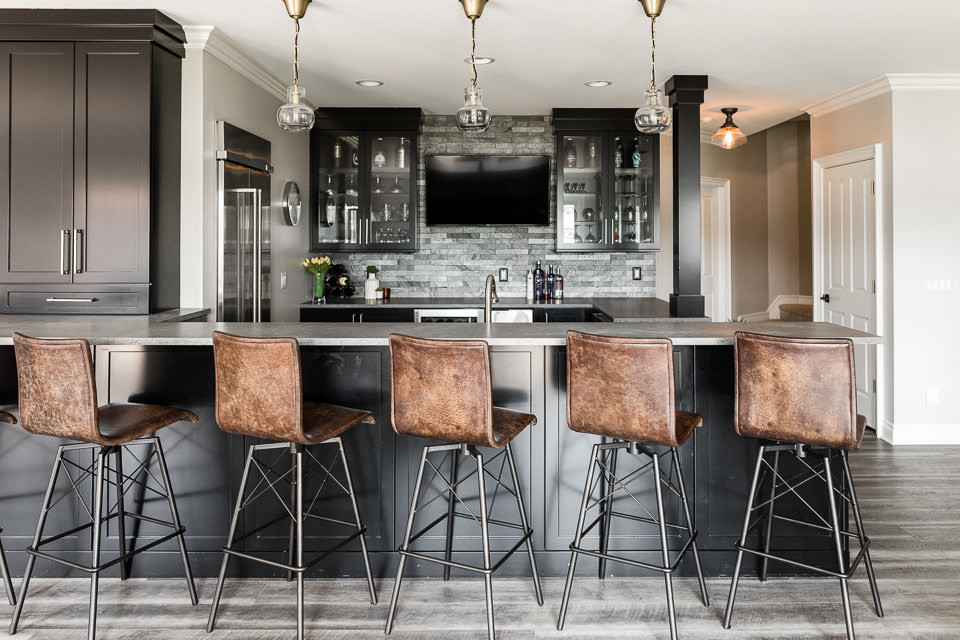 This lower level bar is the focal center for a busy family of five. Spending Michigan summers on the lake and entertaining friends and family sets the need for a design that allows for quick access an