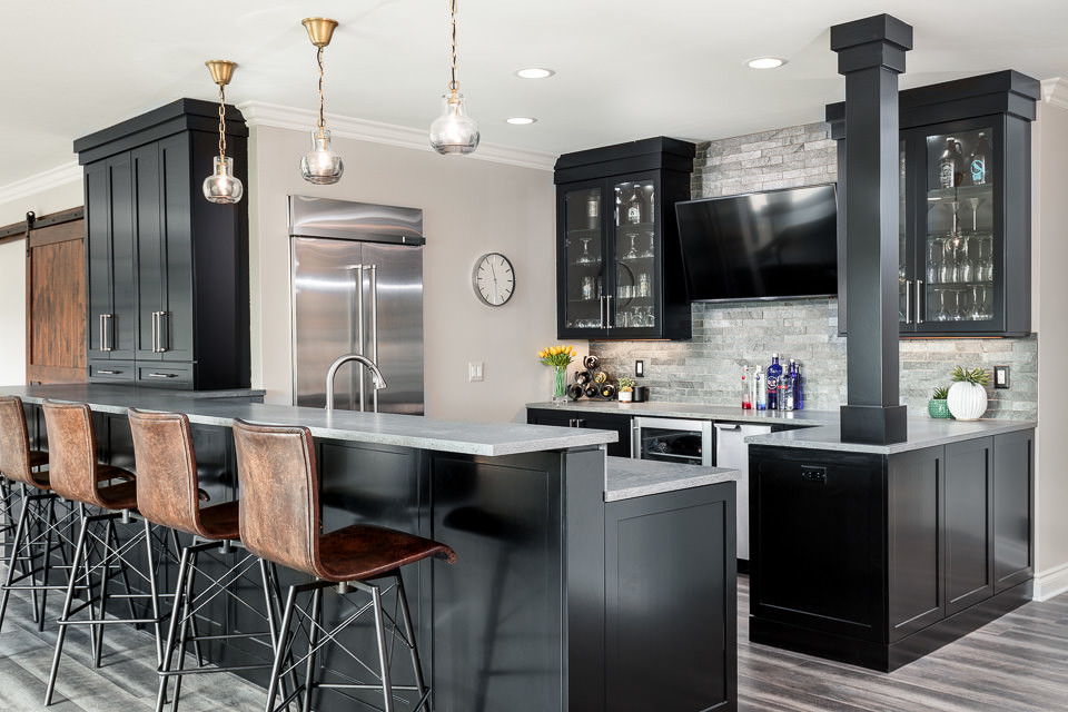 The perfect space for entertaining includes large countertop space for serving as well as hidden appliances for prep work: ice maker, wine fridge, large recessed standing refrigerator, sink and dishwa