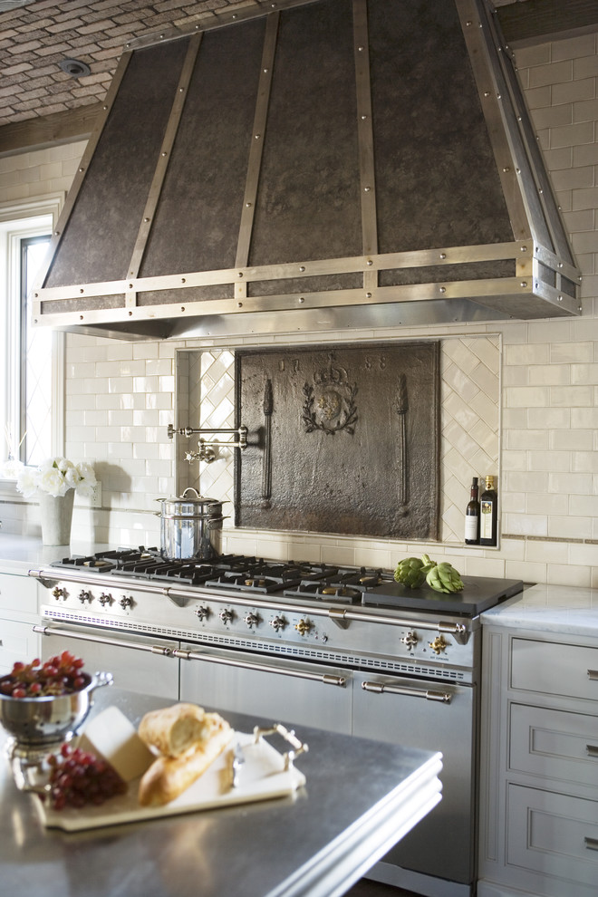 Large transitional galley open concept kitchen photo in Other with recessed-panel cabinets, white cabinets, marble countertops, stainless steel appliances, an island, beige backsplash and subway tile backsplash