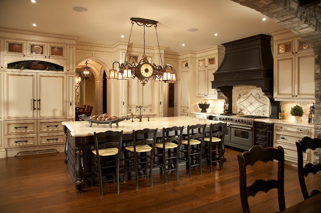 black distressed kitchen cabinets in this large traditional kitchen