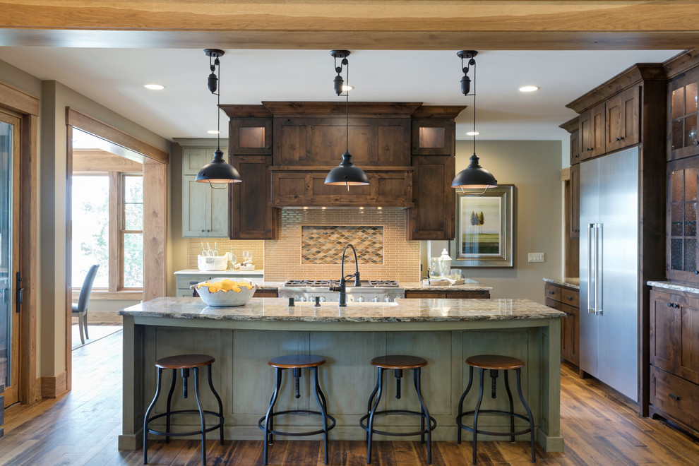 Inspiration for a large rustic u-shaped medium tone wood floor and brown floor kitchen pantry remodel in Minneapolis with a farmhouse sink, distressed cabinets, quartz countertops, beige backsplash, ceramic backsplash, stainless steel appliances and an island