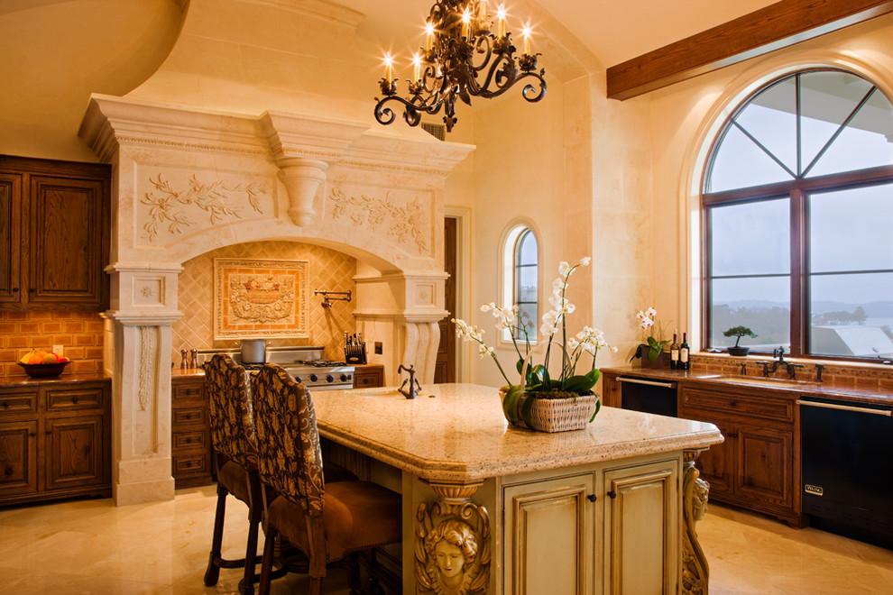 Kitchen - mediterranean kitchen idea in Austin with an undermount sink, raised-panel cabinets, medium tone wood cabinets, beige backsplash and stainless steel appliances