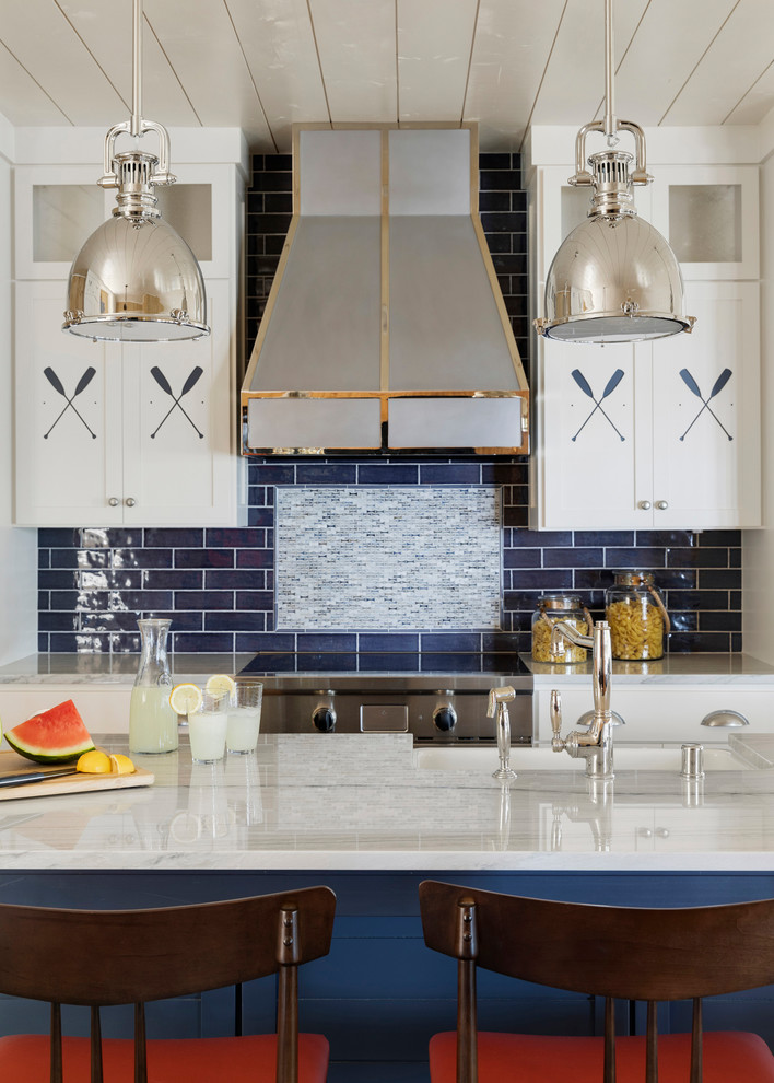 Open concept kitchen - mid-sized coastal single-wall shiplap ceiling open concept kitchen idea in Minneapolis with a farmhouse sink, shaker cabinets, white cabinets, marble countertops, blue backsplash, subway tile backsplash, stainless steel appliances, an island and white countertops