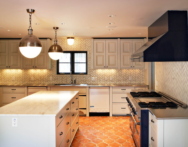 Example Of A Tuscan Terra Cotta Floor And Orange Kitchen Design In Dallas With