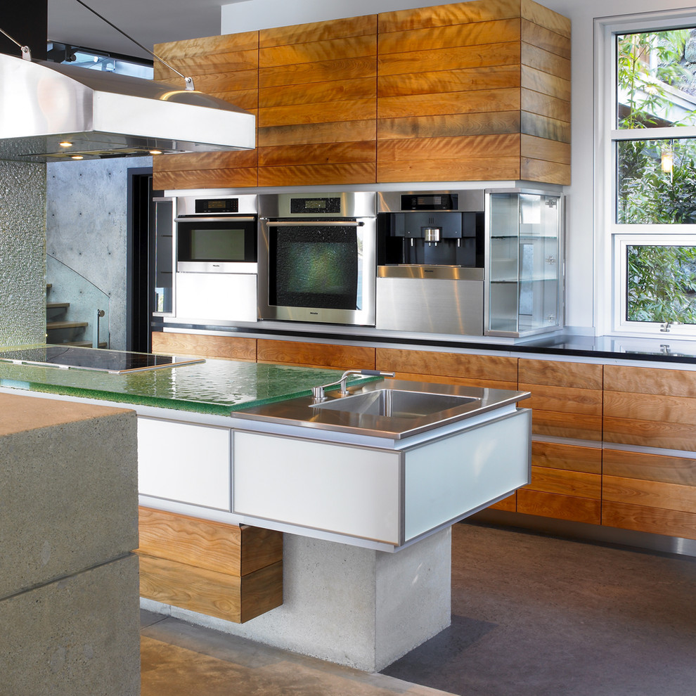 Trendy kitchen photo in Vancouver with glass countertops