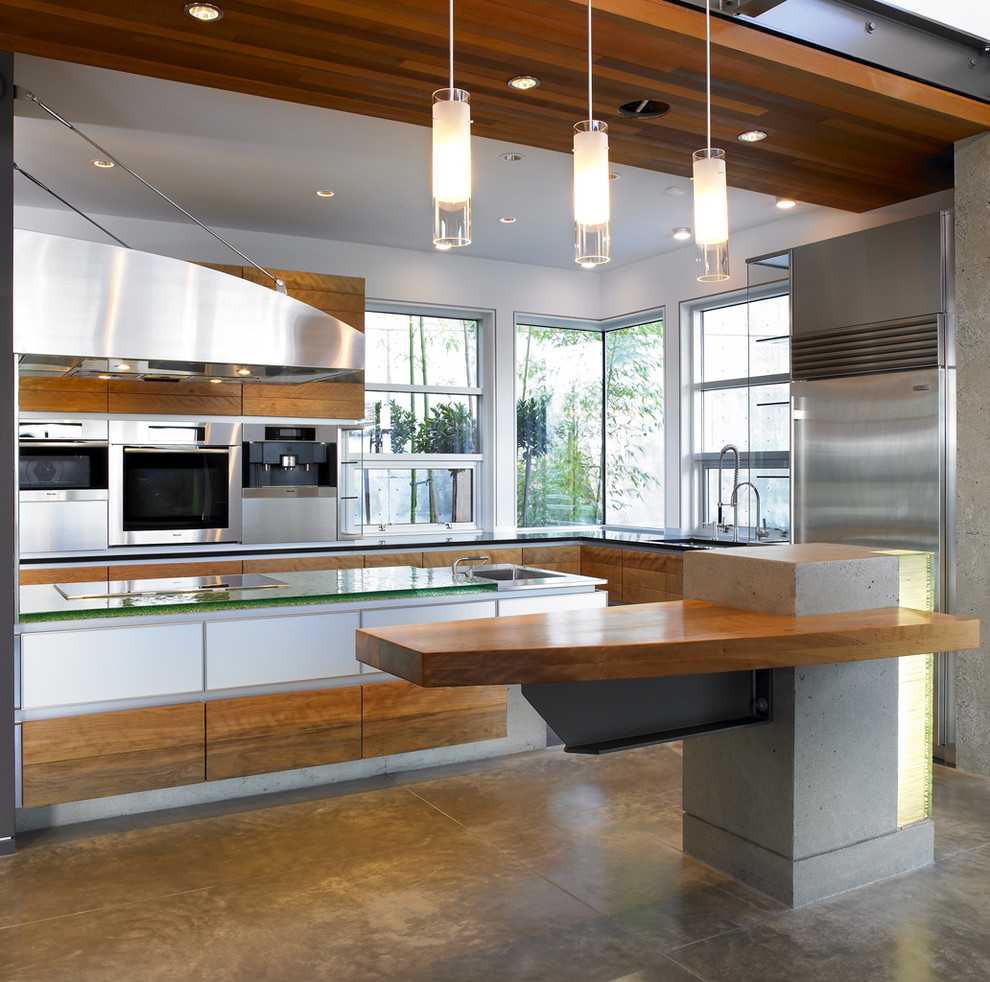 Example of a trendy kitchen design in Vancouver with glass countertops