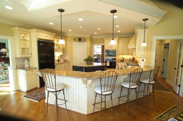 Large open kitchen with eat at bar and island ...