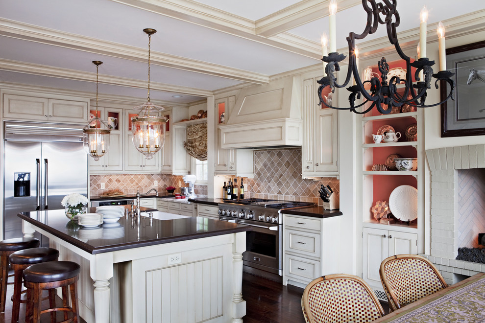 Inspiration for a timeless kitchen remodel in Los Angeles with beaded inset cabinets, stainless steel appliances and white cabinets