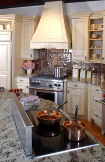 Latte Cabinets With A Copper Backsplash Traditional Kitchen Boston By Clarke Appliance