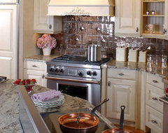 Latte cabinets with a copper backsplash traditional-kitchen