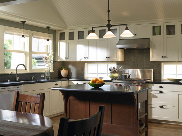 Inspiration for a timeless eat-in kitchen remodel in Seattle with stainless steel appliances, granite countertops, shaker cabinets, white cabinets, gray backsplash and limestone backsplash