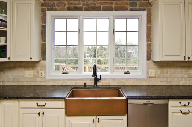 Leathered antique brown granite and river valley granite in vienna va traditional kitchen - Black granite countertops with cream cabinets ...