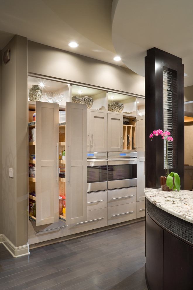 Inspiration for a contemporary kitchen remodel in Kansas City with shaker cabinets and beige cabinets