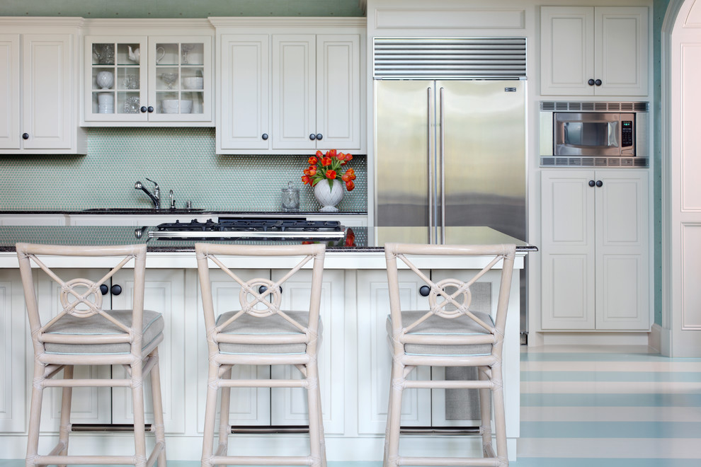 Mid-sized elegant single-wall painted wood floor eat-in kitchen photo in Little Rock with an undermount sink, raised-panel cabinets, white cabinets, blue backsplash, stainless steel appliances and an island