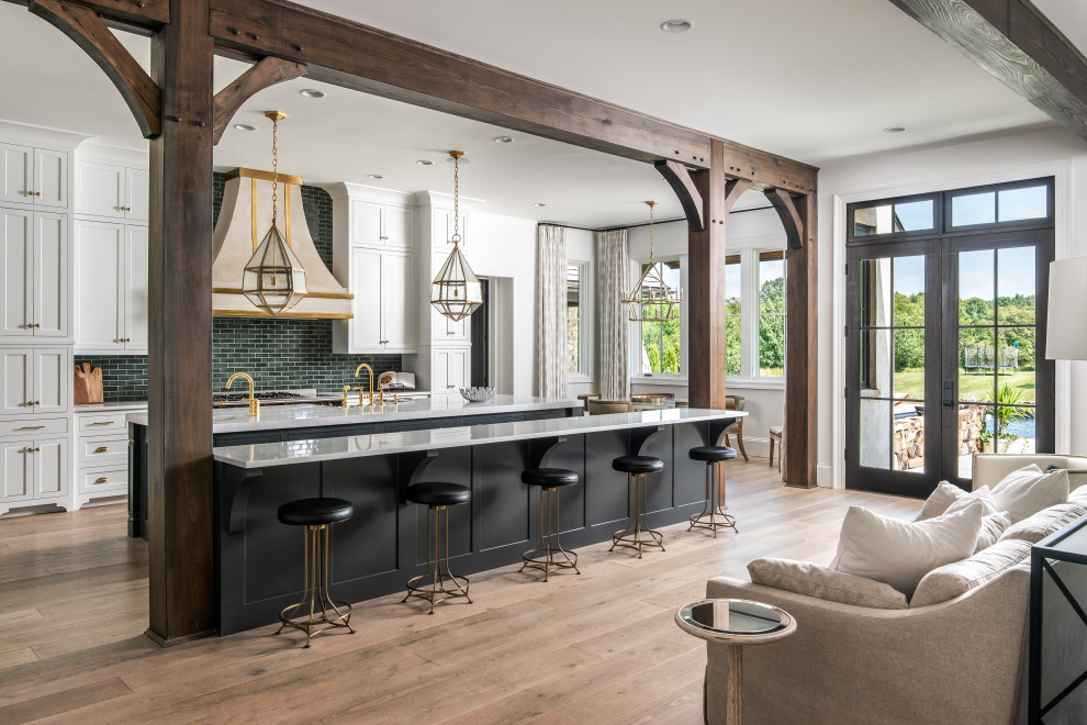Open concept kitchen - large transitional galley medium tone wood floor and brown floor open concept kitchen idea in Nashville with shaker cabinets, white cabinets, marble countertops, green backsplash, two islands and white countertops