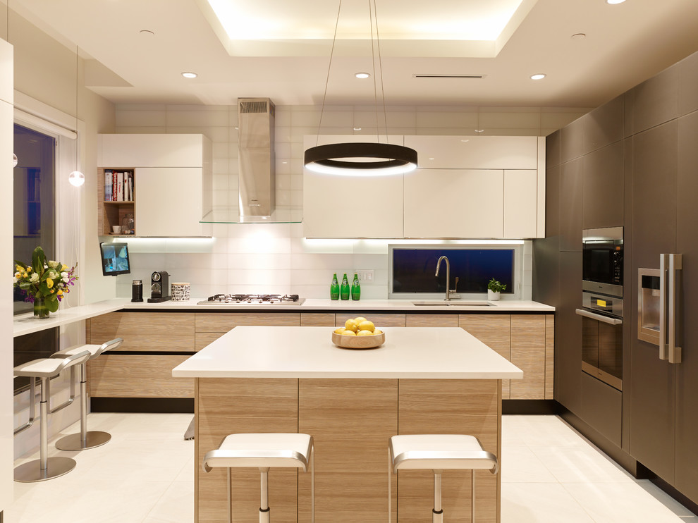 Inspiration for a small contemporary u-shaped ceramic tile kitchen remodel in Vancouver with a double-bowl sink, flat-panel cabinets, quartz countertops, white backsplash, glass tile backsplash, paneled appliances, an island and white cabinets