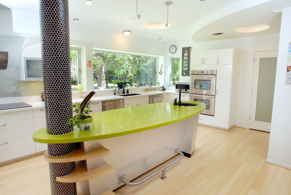 Inspiration for an eclectic kitchen remodel in Houston with stainless steel appliances, quartz countertops and green countertops