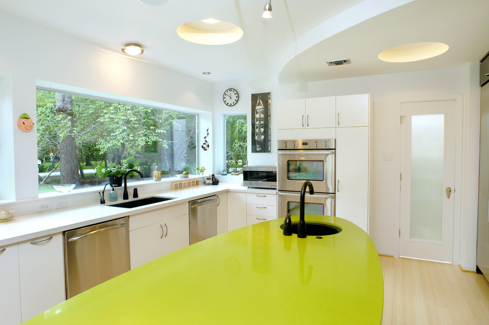 Eclectic kitchen photo in Houston with stainless steel appliances