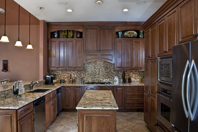 Inspiration for a mid-sized timeless u-shaped ceramic floor eat-in kitchen remodel in DC Metro with stainless steel appliances, granite countertops, an undermount sink, raised-panel cabinets, medium tone wood cabinets, multicolored backsplash, mosaic tile backsplash and an island