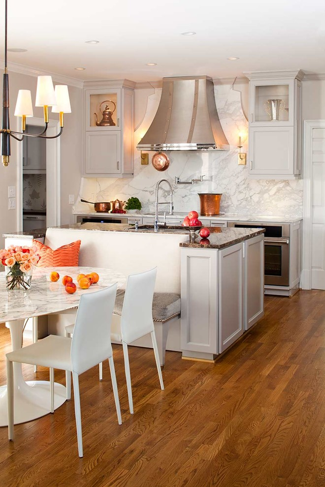 Example of a transitional kitchen design in Atlanta with stainless steel appliances