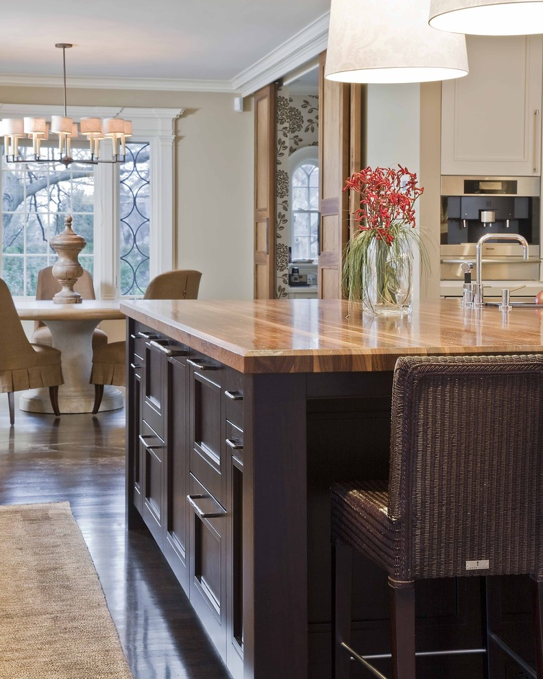 Inspiration for a timeless eat-in kitchen remodel in Boston with wood countertops