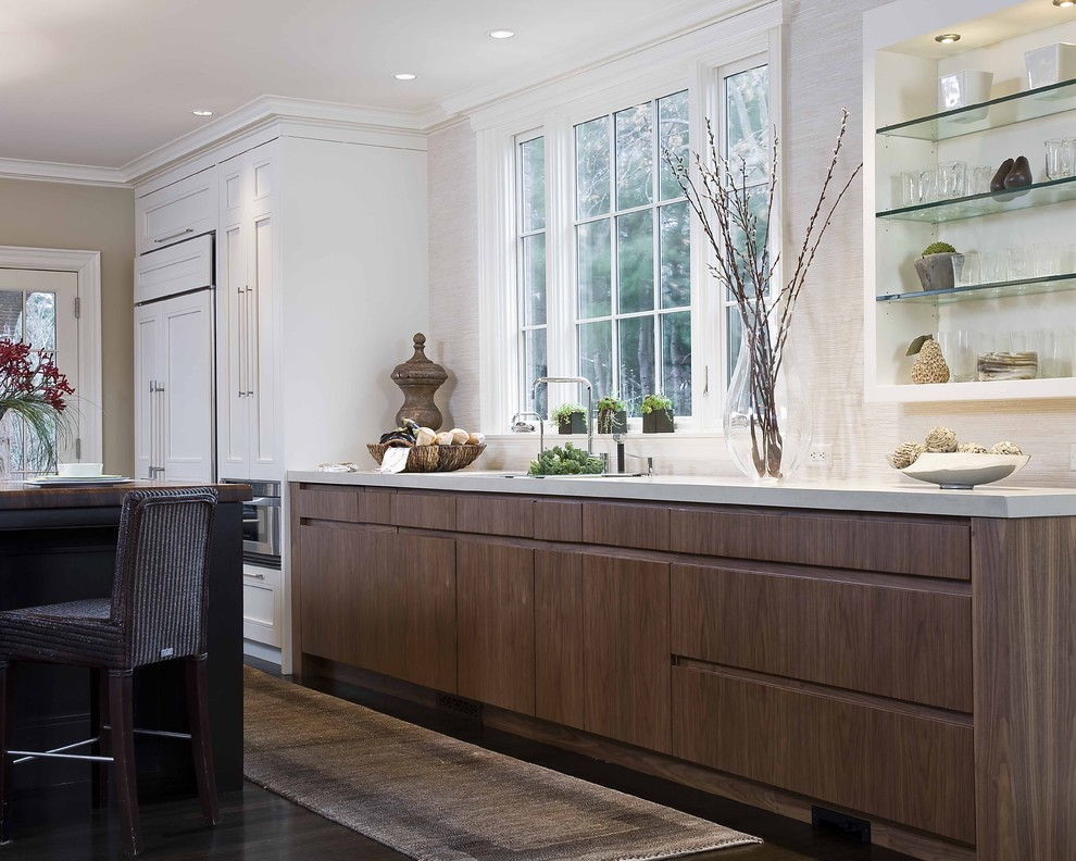 Elegant kitchen photo in Boston with open cabinets, quartz countertops and paneled appliances