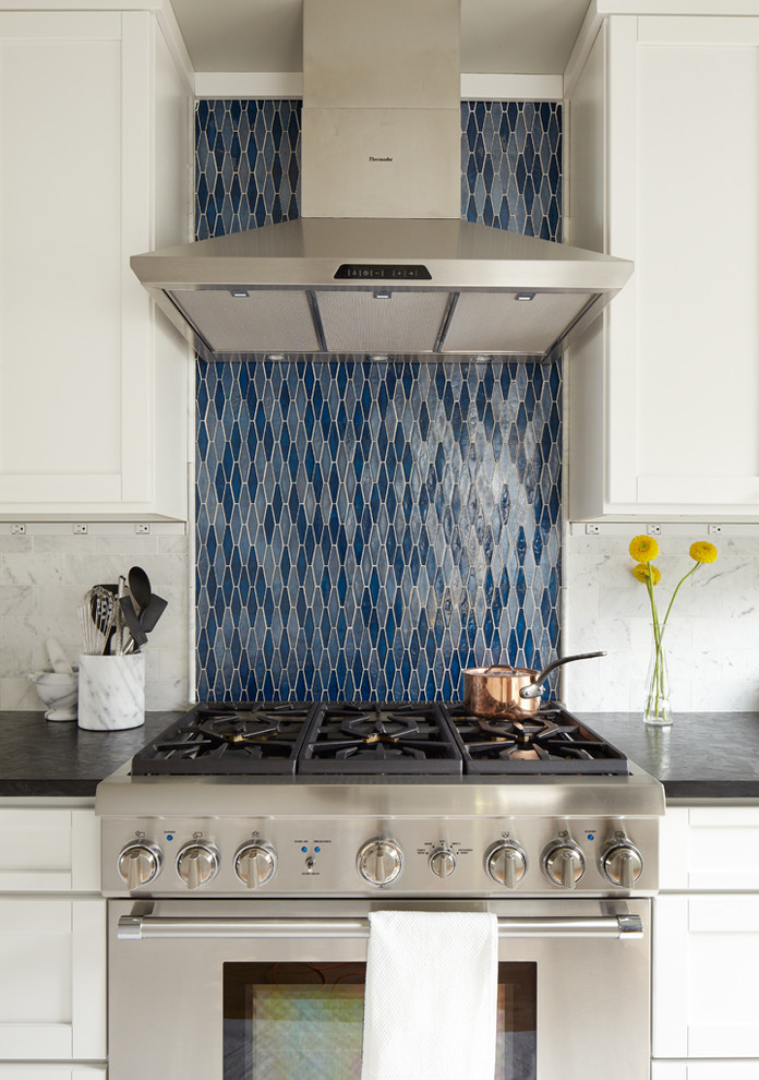 Example of a mid-sized classic single-wall light wood floor eat-in kitchen design in Seattle with blue backsplash, stainless steel appliances, an undermount sink, shaker cabinets, white cabinets, onyx countertops, stone tile backsplash and no island