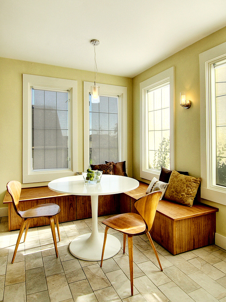 Example of an eclectic eat-in kitchen design in Seattle with medium tone wood cabinets