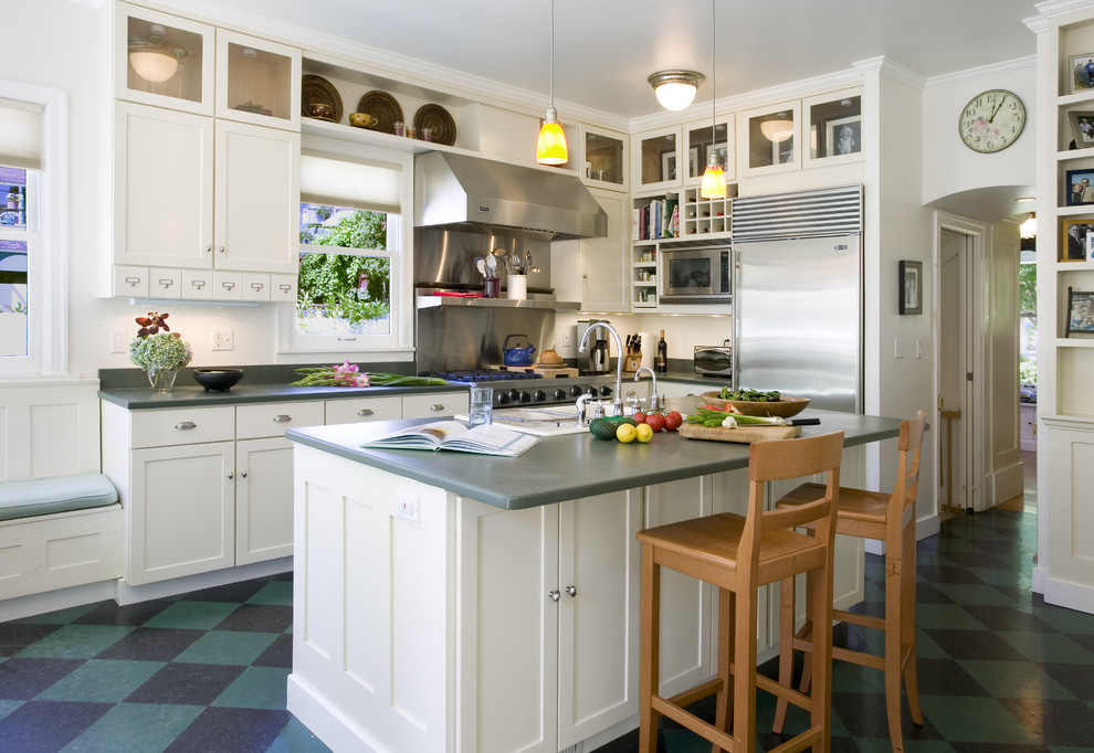 Elegant l-shaped multicolored floor kitchen photo in Seattle with shaker cabinets, white cabinets and stainless steel appliances