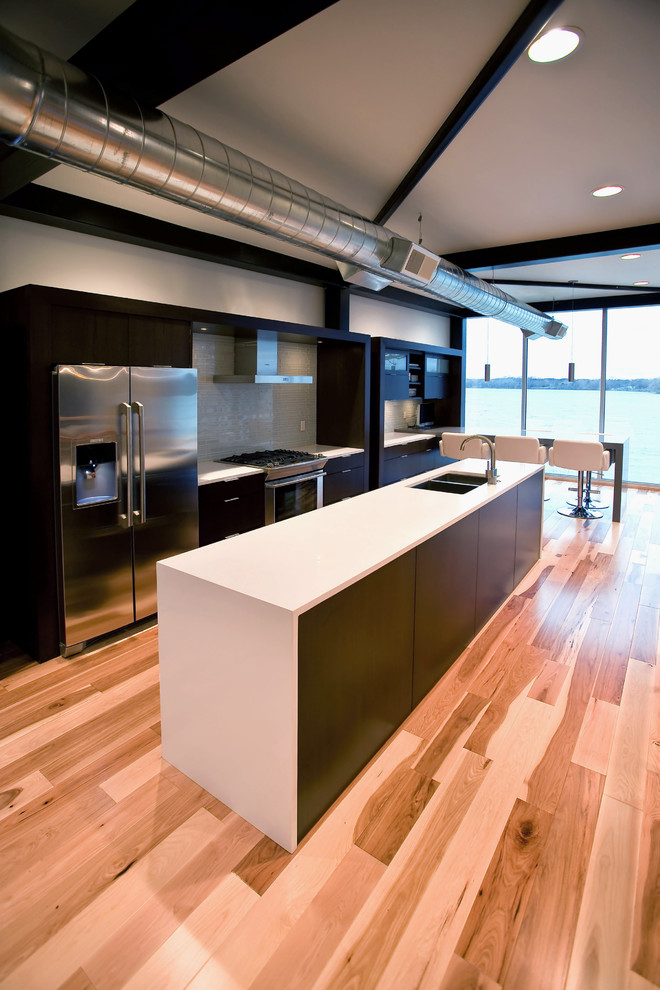 Kitchen - industrial kitchen idea in Minneapolis with stainless steel appliances