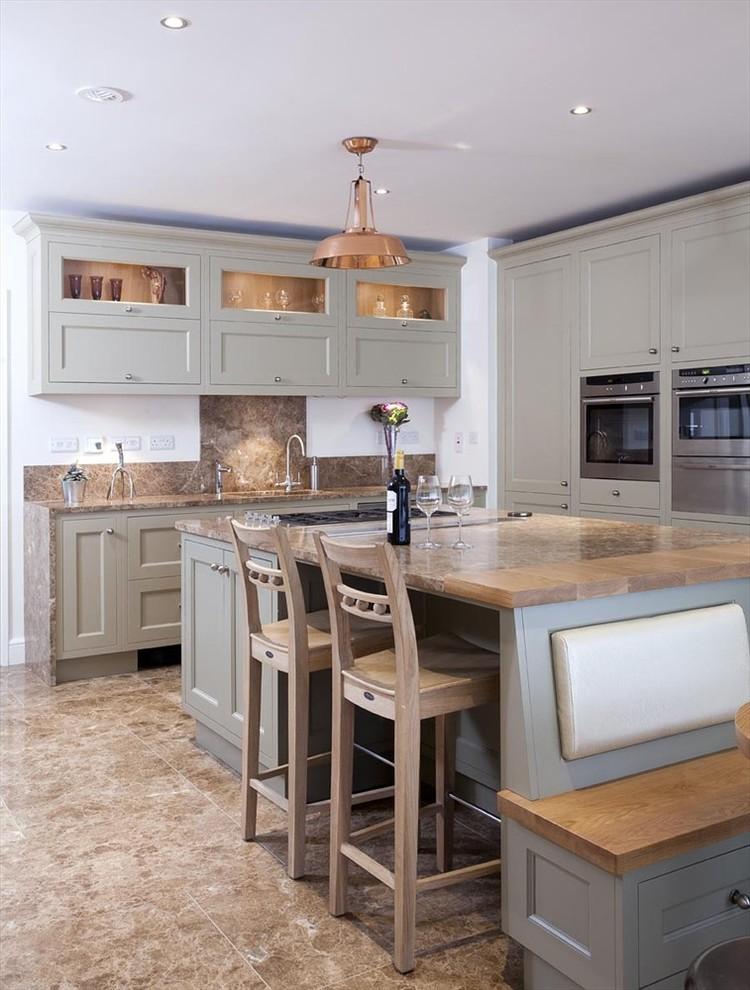 Inspiration for a timeless l-shaped kitchen remodel in Dublin with an undermount sink, recessed-panel cabinets, green cabinets, brown backsplash and stainless steel appliances