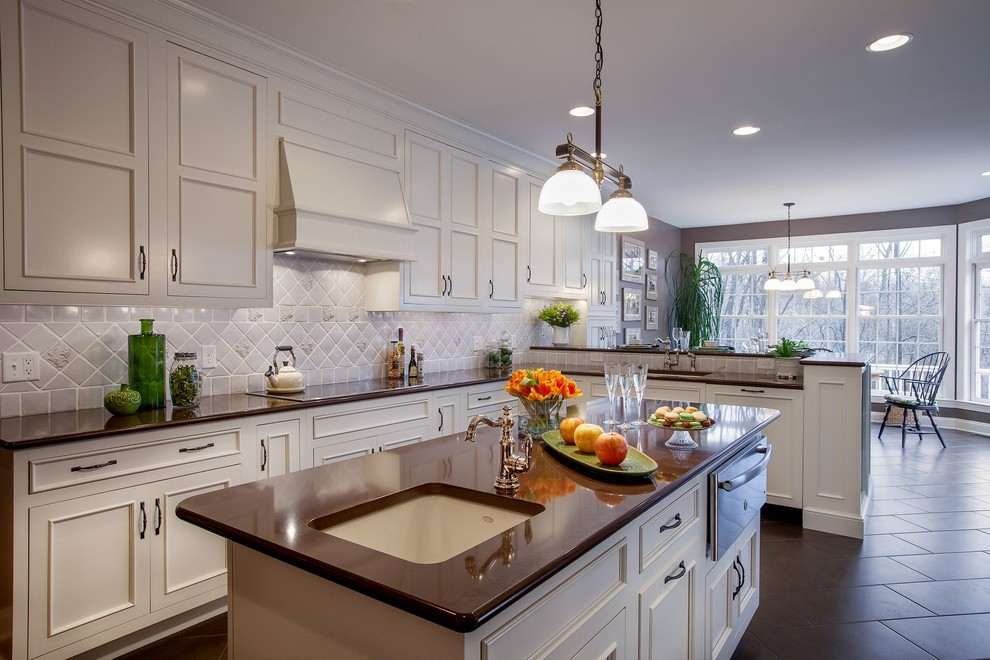 Eat-in kitchen - large transitional l-shaped slate floor eat-in kitchen idea in Philadelphia with an undermount sink, recessed-panel cabinets, white cabinets, gray backsplash, ceramic backsplash, an island, quartz countertops and stainless steel appliances