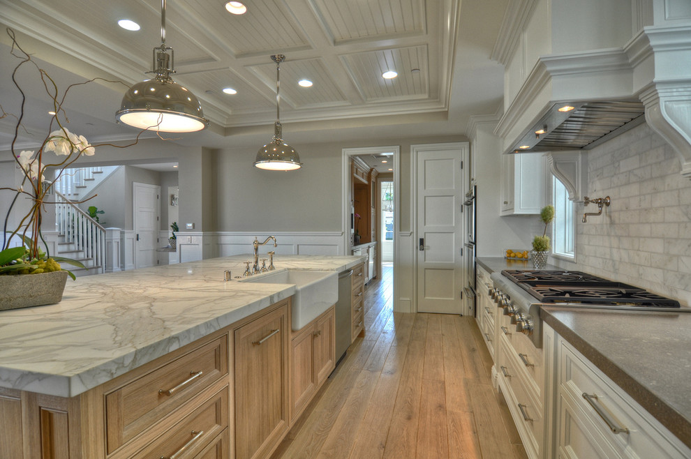 Elegant kitchen photo in Orange County with stainless steel appliances and a farmhouse sink