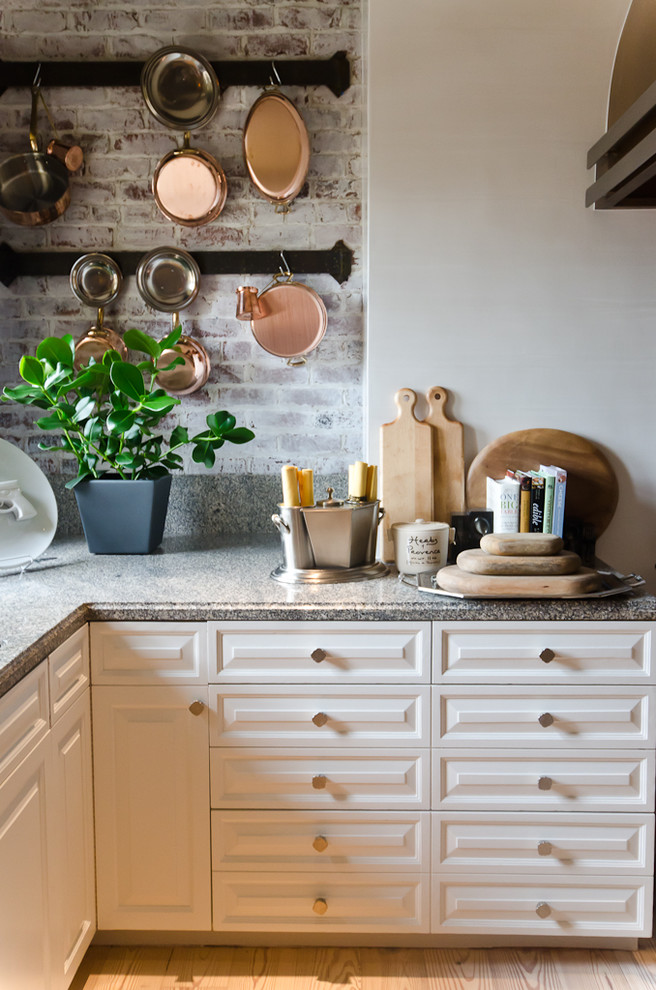 Inspiration for a timeless kitchen remodel in San Francisco with raised-panel cabinets and white cabinets