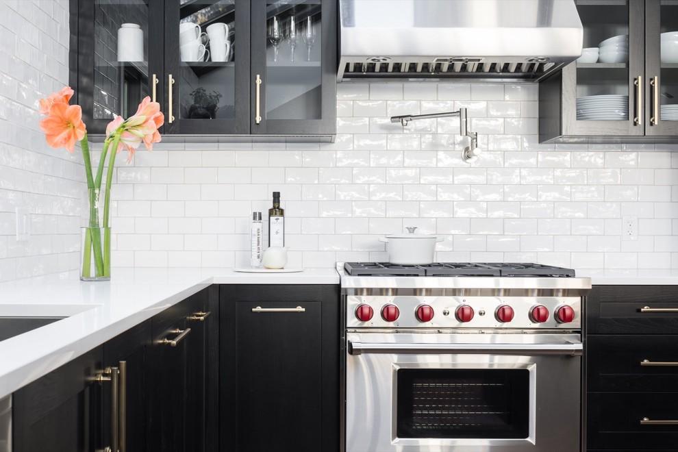 Transitional kitchen photo in Calgary with shaker cabinets, black cabinets, white backsplash and subway tile backsplash