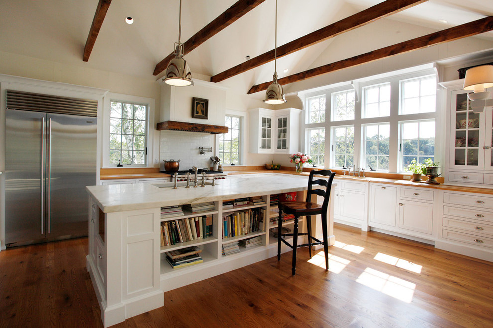 Kitchen - farmhouse l-shaped kitchen idea in Philadelphia with stainless steel appliances, recessed-panel cabinets, white cabinets, marble countertops, white backsplash and subway tile backsplash