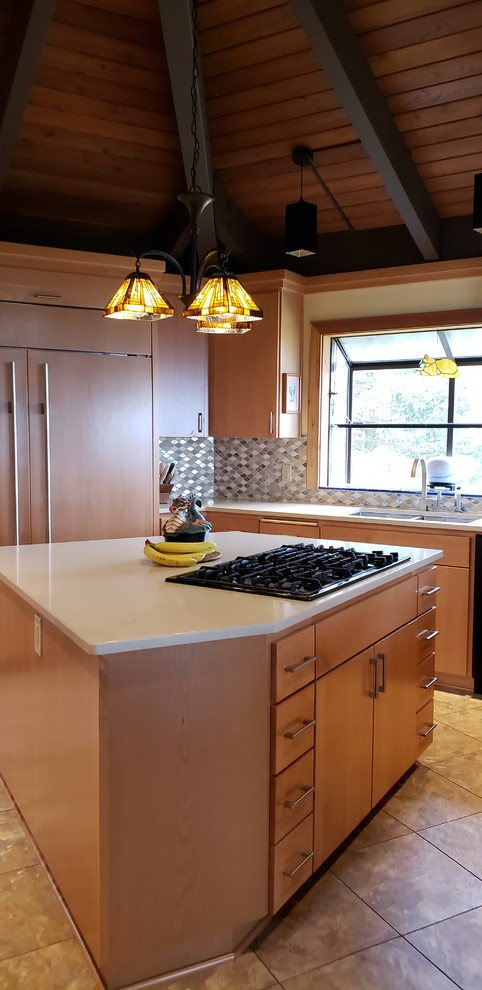 Inspiration for a mid-sized transitional u-shaped laminate floor and beige floor eat-in kitchen remodel in Portland with a double-bowl sink, flat-panel cabinets, light wood cabinets, quartzite countertops, multicolored backsplash, glass tile backsplash, paneled appliances, an island and beige countertops