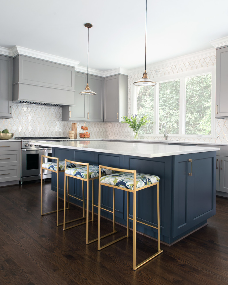 Kitchen - transitional l-shaped dark wood floor and brown floor kitchen idea in Charlotte with shaker cabinets, gray cabinets, white backsplash, stainless steel appliances, an island and white countertops