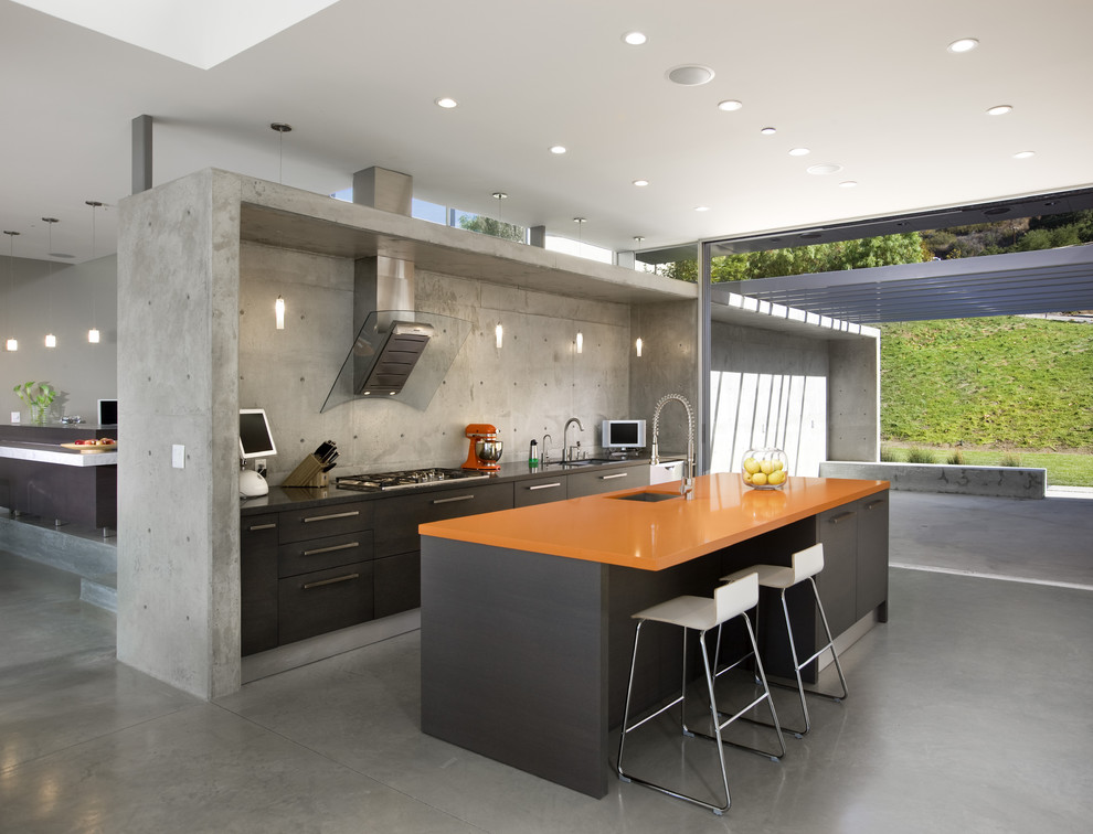 Inspiration for a modern kitchen remodel in Los Angeles with an undermount sink, flat-panel cabinets, brown cabinets and orange countertops