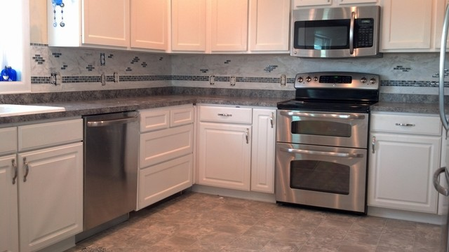 Kitchen Backsplash Accents limestone backsplash with glass tile accent