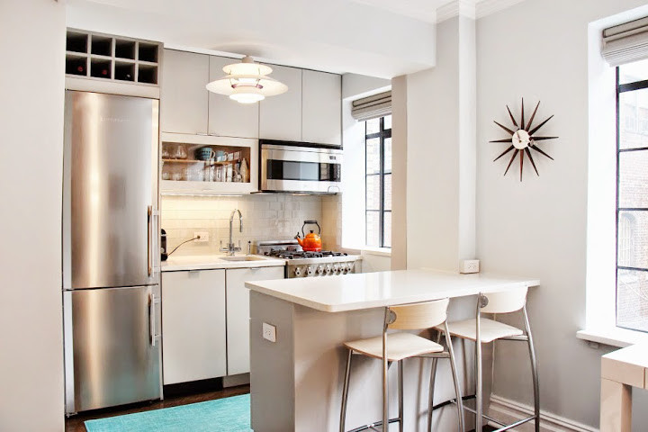 Small minimalist galley dark wood floor and brown floor open concept kitchen photo in New York with an undermount sink, gray cabinets, quartz countertops, white backsplash, glass tile backsplash, stainless steel appliances, a peninsula and flat-panel cabinets
