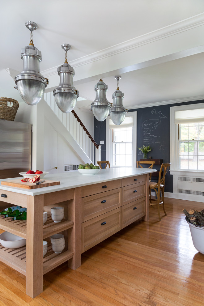 Inspiration for a large transitional medium tone wood floor kitchen remodel in Bridgeport with a farmhouse sink, shaker cabinets, medium tone wood cabinets, marble countertops, white backsplash, subway tile backsplash and an island