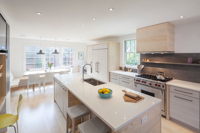 Inspiration for a contemporary galley light wood floor eat-in kitchen remodel in Boston with a double-bowl sink, flat-panel cabinets, light wood cabinets, gray backsplash, stainless steel appliances, an island and stone tile backsplash