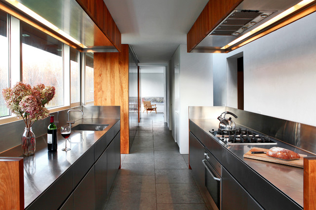 Trendy kitchen photo in New York with an integrated sink, flat-panel cabinets, metallic backsplash and no island